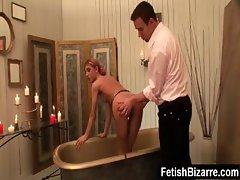 Blonde slave gets into the bath chained up and is then spanked