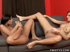 Two brunette lesbian babes play with feet and lick pussies