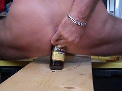 beer bottle in my butt