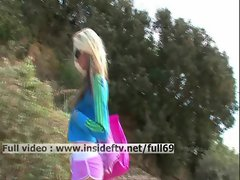 Suzanna _ Amateur blonde acting naughty on a public beach