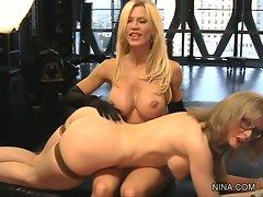 Whores Amber Lynn & Nina Hartley spank each other