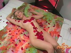 Hot ass chick Ashley Fires rolls sexy nude body in a bed of roses
