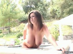 Sara Stone playing with her huge knockers and teasing the camera
