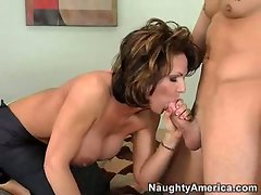Sexy milf Deauxma satisfies her hunger pains by munching on a fat juicy cock