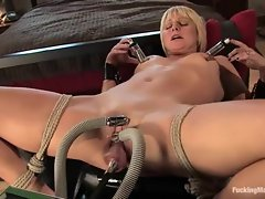 Super slutty bitch is clamped up and gets her twat hammered by a horny robot