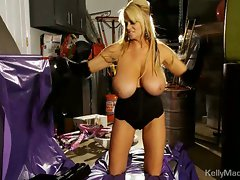 Big titted Kelly Madison reveals her massive tits