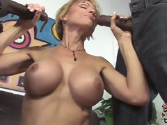 Cameron gets her mouth around two black cocks