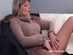 Mature whore teasing her pussy