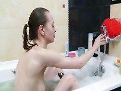 Skinny super teenager in bubble bath