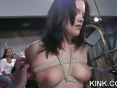 Pretty hot babe bound, oiled