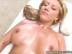 Bigbreasted babe enjoys a stimulating massage