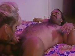 Big tit hooker sucks off midget