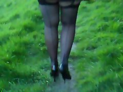 seamed stockings pleated miniskirt