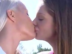 Blonde and brunette tongue kiss