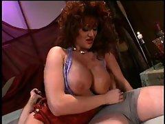 Renee Larue-Busty Redhead Cougar