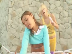 Girly fun outdoors of two babysitters
