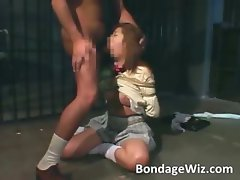 Tied up Asian slut in ropes sucks dick