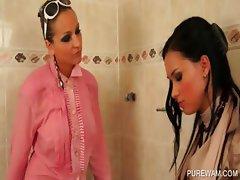 Sexy lesbos get wet in bathtub