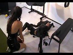 Lesbian domina spanks her slave girl