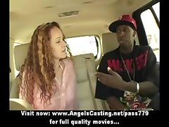 Sensual babe with long red hair does blowjob for afro guy in the car