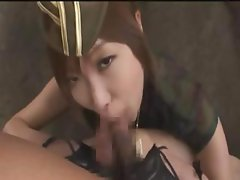 Asian skank in a sexy uniform goes down on a couple of dongs