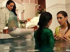 Fully clothed women take a dip in the pool