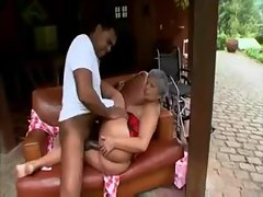 Black granny in corset takes young black dick