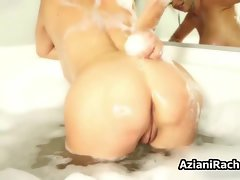 Cougar with huge tits soaping them up in the bathtub