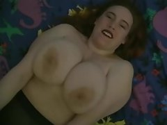 Overweight girl shakes her big titties on camera