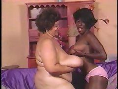Black mature with huge tits has lesbian sex