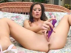 Her purple toy is a pussy pleasure device