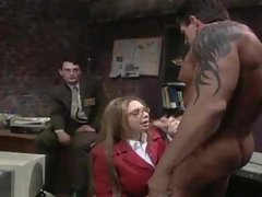 Chick in the office sucks on a dick