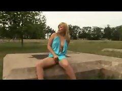 Girl in a slutty dress masturbating outdoors