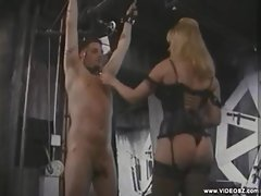 He gets whipped by his blonde mistress