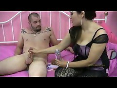 Sexy girl lubes him up and gives a footjob