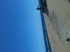 wanking on public beach
