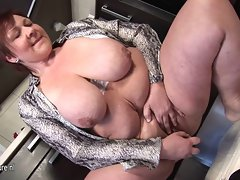 Big breasted mature mom playing in her kitchen
