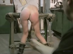Brutal ass and leg spanking for Lola.