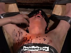 Twink tortured with hot candle wax in gay bdsm scene