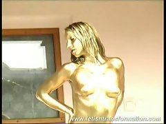 Sexy chick washing off the gold paint in her body