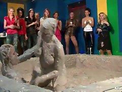 Lesbian babes in brutal mud wrestling battle
