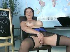 Horny mature teacher rubs her clit