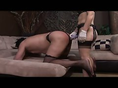 Redhead mistress gemini spanks and strapon fucks her slave