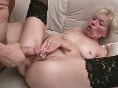 Sexy granny in stockings rammed by young cock