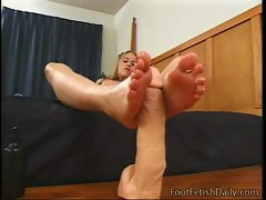 Sexy blonde feet fucks the dildo
