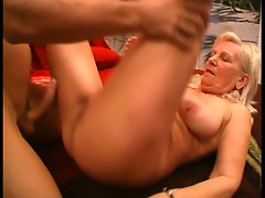 Blonde granny fucked hard by a young cock !