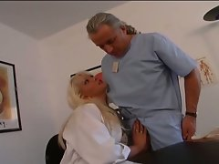 Horny blonde doctor takes a whole cock in