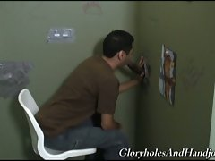 Sissy guy sucks cock from a glory hole