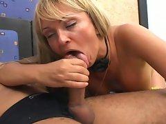 Tranny blows a juicy hard cock