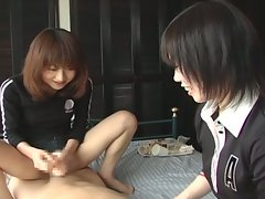 Two asian sluts playing with cock
